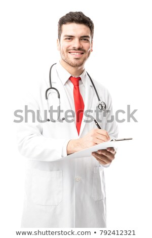 Handsome doctor writing on medical chart Stock photo © sumners