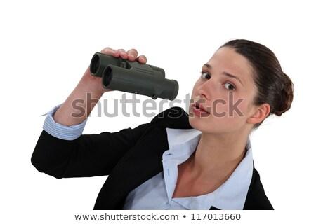 Curious businesswoman holding pair of binoculars Stock photo © photography33