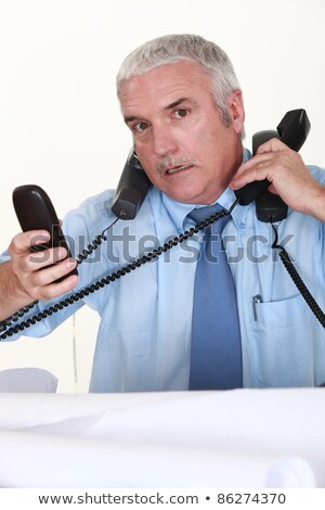 Overwhelmed man answering ringing telephones Stock photo © photography33