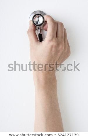 Orvos tart ki sztetoszkóp női szív Stock fotó © wavebreak_media