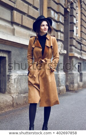 Nice girl in black leggings with a handbag stock photo © acidgrey