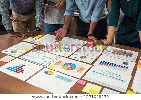 businessman showing a report to a colleague Stock photo © photography33