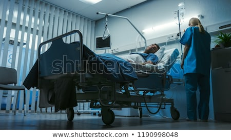 Hasta adam oturma yatak sıcak Stok fotoğraf © ivonnewierink