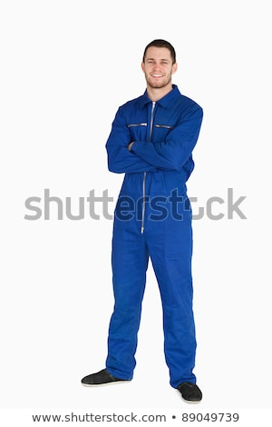 Smiling mechanic in boiler suit against a white background Stock photo © wavebreak_media