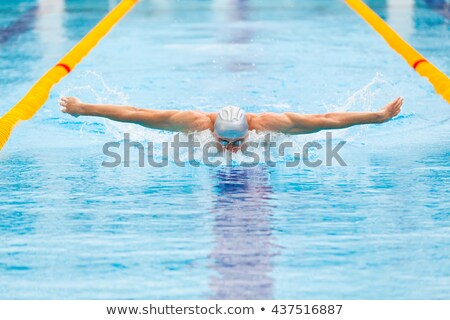 dynamic swimmer in pool Stock photo © photochecker