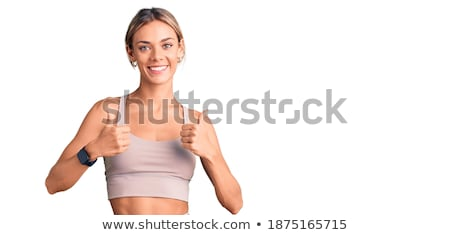 Portrait of happy woman in sportswear gesturing okay sign Stock photo © wavebreak_media