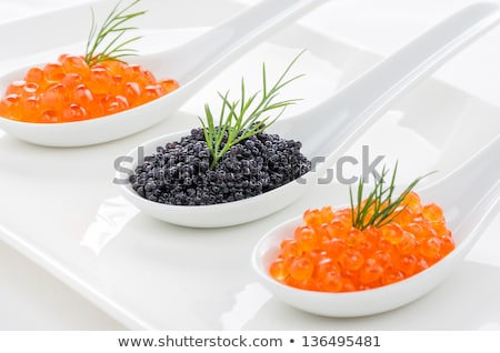Red And Black Caviar On Porcelain Spoons Photo stock © Zerbor