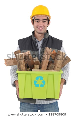 A construction worker recycling wooden scraps. Stock photo © photography33