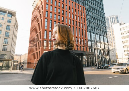 Photo of young girl posing, looking away. Stock photo © PawelSierakowski