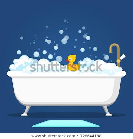 Home bathroom interior with bubble bath Stock photo © dashapetrenko