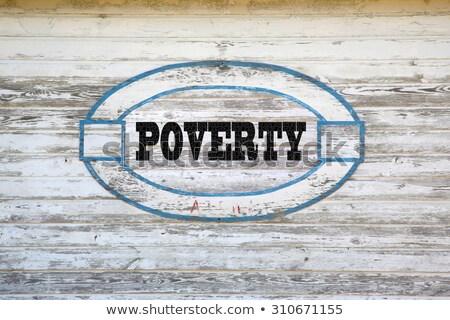 Charity Concept on Weathered Warning Sign. Stock photo © tashatuvango
