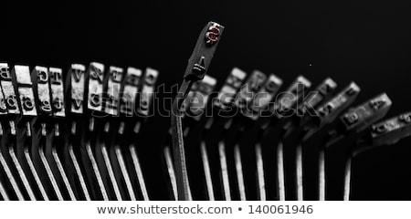 crisis on old typewriters keys stock photo © tashatuvango