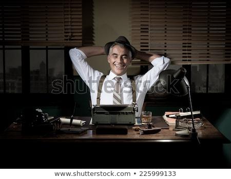 Stock photo: Writer or reporter behind the typewriter