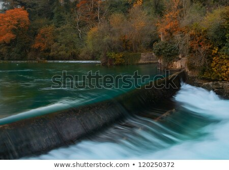 weirs on river in fontaine de vaucluse france stock photo © nejron