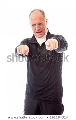 Confident senior man pointing towards camera with both hands Stock photo © bmonteny