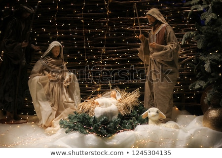 Figurines of a family celebrating Christmas eve Stock photo © bmonteny
