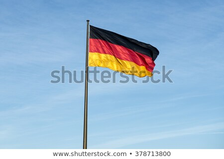 germany flag on blue sky stock photo © 5xinc