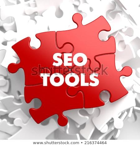 SEO Tools on Red Puzzle. Stock photo © tashatuvango