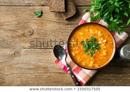 wooden background with copy space   brown lentils stock photo © zerbor