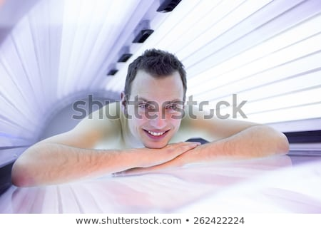 Handsome young man relaxing in a modern  solarium Stock photo © lightpoet