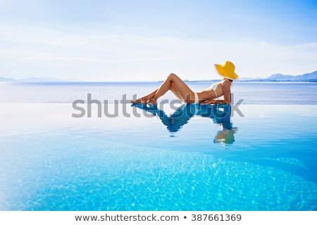 красивая женщина бассейна красивой сексуальная женщина сидят Бассейн Сток-фото © clearviewstock