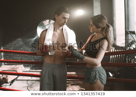 Sport attractive man wearing boxing bandages with bottle of wate Stock photo © vlad_star