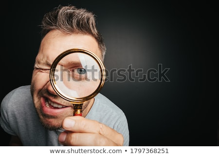 portrait of a man with big eyes looking at camera stock photo © deandrobot