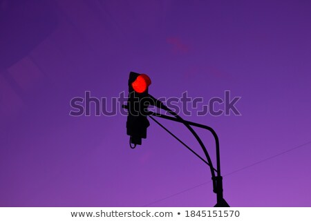 red traffic light in a dramatic sunset stock photo © capturelight