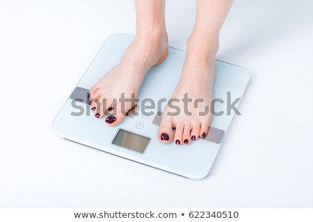 Cropped image of model with weight scale Stock photo © deandrobot