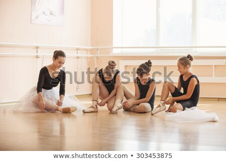 four ballet dancers practice in the room stock photo © bluering