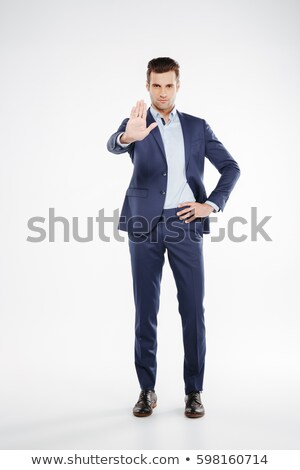 Full length portrait of business man showing stop sign Stock photo © deandrobot