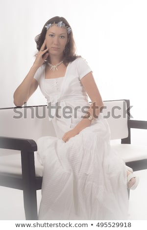 Belle fille séance président jambes Photo stock © AntonRomanov