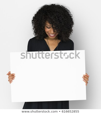 African woman holding banner isolated on white background Stock photo © NikoDzhi