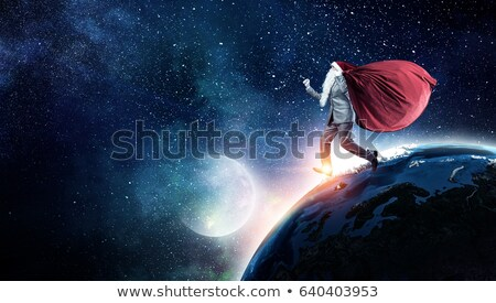 Święty mikołaj ziemi christmas planety duży czerwony Zdjęcia stock © popaukropa