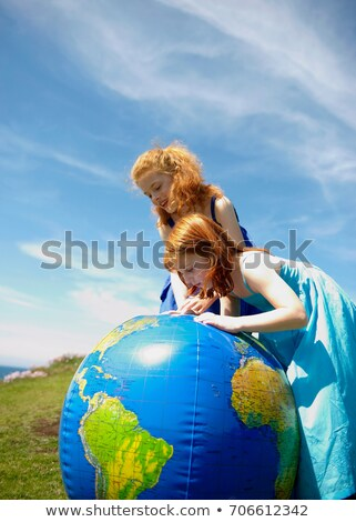 2 girls looking at inflatable globe Stock photo © IS2