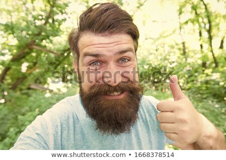 man grooming beard Stock photo © LightFieldStudios