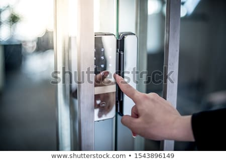 Hand Touching Service Keypad. Stock photo © tashatuvango