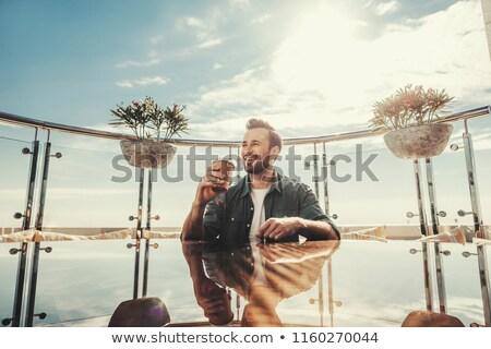Férfi ül erkély étel kávé szabadság Stock fotó © IS2