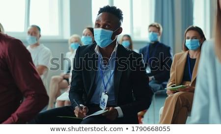 Businessman listening to presentation Stock photo © IS2