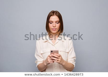 serious trendy young woman using her mobile stock photo © giulio_fornasar