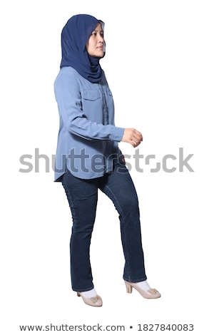 smiling businesswoman walking to side confidently Stock photo © feedough