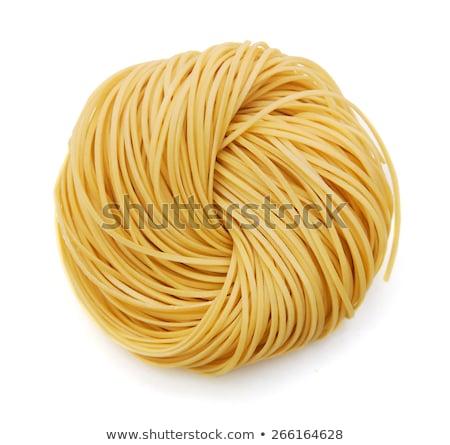 Rolls of uncooked spaghetti Stock photo © dash