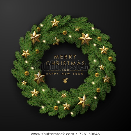 Christmas wreath made of naturalistic looking pine branches decorated with gold bows, red berries an Stock photo © ikopylov