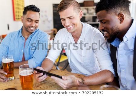 Adam içme bira bar birahane Stok fotoğraf © dolgachov