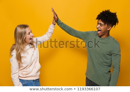 Photo of beautiful students man and woman 16-18 with dental brac Stock photo © deandrobot