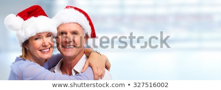 close up of happy senior couple at christmas stock photo © dolgachov