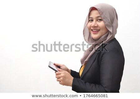 アラブ ビジネス女性 立って タブレット 携帯電話 ベクトル ストックフォト © NikoDzhi