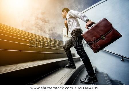 Empresário maneira caminhada pasta mão Foto stock © ra2studio