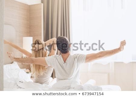 Jovem feliz casal quarto de hotel manhã Foto stock © ruslanshramko