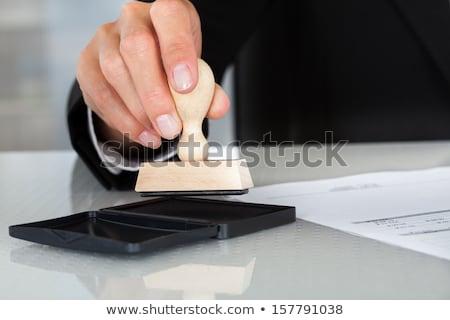 üzletember · kéz · kisajtolás · pecsét · irat · közelkép - stock fotó © andreypopov